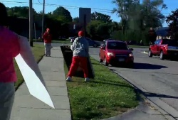sign throwing guy